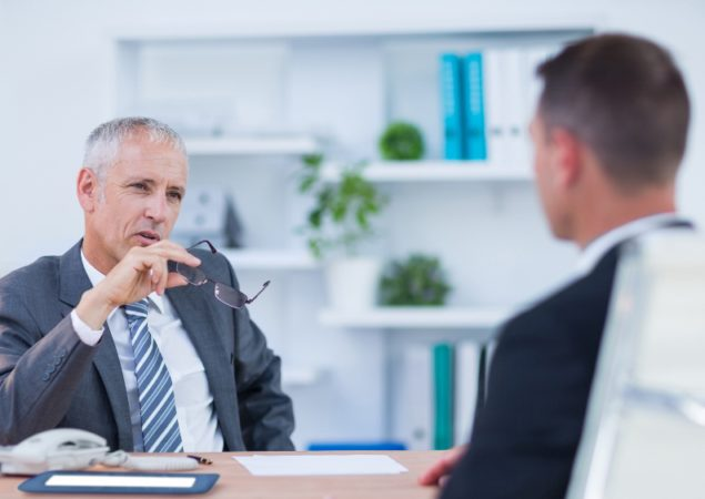 http://www.dreamstime.com/royalty-free-stock-photo-two-serious-businessmen-speaking-working-office-image56483155